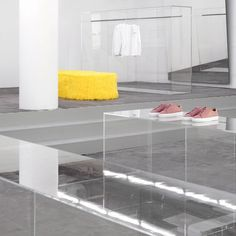(10) When designing this pop-up store for fashion brand Axel Arigato, Christian Halleröd brought colour to the minimal space through yellow-tinted windo… | Pinterest