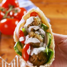 Falafel will forever be one of our favorite on-the-go meals. Though nothing's faster than picking up a sandwich from your favorite falafel joint, we promise that making these falafel balls is a cinch. Vegetarian Recipes, Cooking Recipes, Healthy Recipes, Vegan Vegetarian, Mediterranean Recipes, Greek Recipes, Food Videos, Delish, Healthy Eating