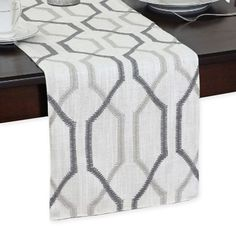 Create a sophisticated table setting with the Softline Ashby Table Runner. This elegant runner will wow your guests with its sleek polyester and linen feel and smooth texture, helping to turn an ordinary evening into a sublime dining experience. Modern Table Runners, Orange Table, Elements Of Design, Table Linens, Home Decor Items, Brown And Grey, Accent Decor, Table Settings, House Styles