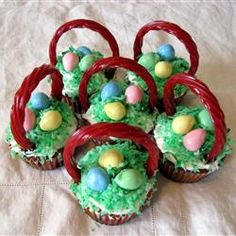 Easter Surprise Cupcakes    Look fun!  Think i will try for grandkids this year...the handle is made of Twizzlers..my favorite candy!