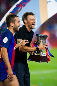 Jordi Alba and Head coach Luis Enrique Martinez of FC Barcelona share a joke after the Spanish Super Cup Final second leg match between FC Barcelona and Sevilla FC at Camp Nou on August 17, 2016 in Barcelona, Catalonia.