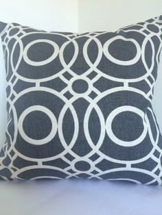 Square 18x18 cushion cover made from Clarke and Clarke Eclipse print 100 % cotton fabric in charcoal/dark grey colour. The pattern placement may vary slightly but will always be similar to that shown in the picture. The back of the pillow cover is made in a plain cream cotton fabric with a zip opening at the bottom for an easy insertion and removal of the insert pad. Please be advised that no insert pad is included. I would recommend to use insert pad one size bigger for that plum loo...