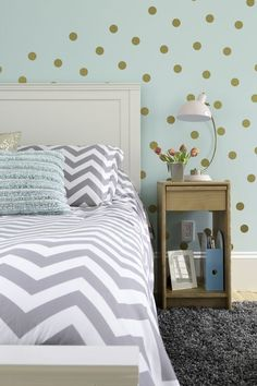 Girl's bedroom in aqua, gray, white and gold color palette with feature wall painted in Sherwin Williams Tame Teal.