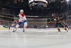 10.23.15 - Habs vs Sabres - Max Pacioretty #67 of the Montreal Canadiens passes the puck against Josh Gorges #4 of the Buffalo Sabres during an NHL game at the First Niagara Center in Buffalo, New York. (Photo by Bill Wippert/NHLI via Getty Images)