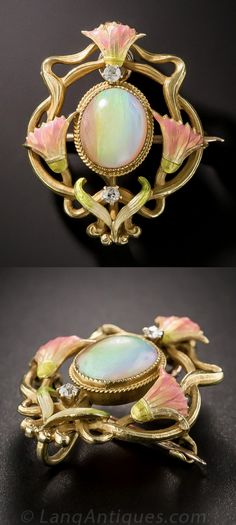 Krementz Art Nouveau Opal Brooch/Pendant,A trio of iridescent pink tulips delicately frame a two carat twilight-colored opal. Artfully designed and crafted in 14 karat gold by the renowned and long standing American jewelery company Krementz in the early 1900s, this enchanting jewel does double-duty as both a brooch and a pendant. Two small mine-cut diamonds twinkle like the first stars at dusk.