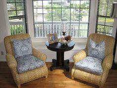 living room chair setup with a bay window bay window furniture