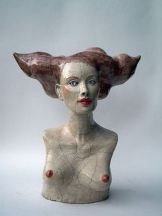 Mélanie Bourget's work focuses on the human being. She creates figurative sculptures in a contemporary yet a little offbeat style, oscillating between realism and fantasy. Then she subjects them to the raku technique. Big busts of women with crazy hairstyles, mysterious and dreamy little characters are in a few words the poetic and fragile characters that live in her world. These creatures are alive; they transmit deep and mixed feelings. And through the cracks of glaze we can see with…