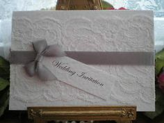 Handmade A6 White Lace Wedding Invitation with Silver Satin Rbbon and Bow | eBay Available from www.vintagelaceweddingcards.co.uk