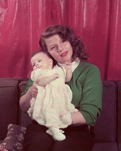 professorrowenaravenclaw:  Actress Rita Hayworth, then married to Prince Aly Khan, with their only child together, Princess Yasmin Aga Khan, 1949