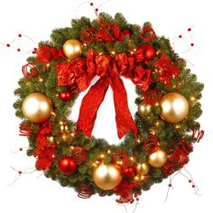The Cozy Christmas Wreath from the National Tree Decorative Collection is trimmed with a red bow, berries and gold and red ball ornaments. This delightful holiday decoration is pre-strung with 100 red and clear lights for hanging indoors or outdoors. Pre Lit Wreath, Christmas Wreaths With Lights, Diy Christmas Tree, Holiday Wreaths, Christmas Holidays, Christmas Decorations, Christmas Ideas, Holiday Decorating, Decorating Ideas