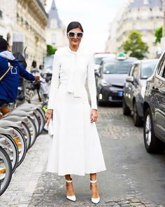 Spotted on the street: @bat_gio in a stark white @giambattistapr dress and matching @gianvitorossi shoes. Photo credit: @thestreetmuse. #NMstreetsyle