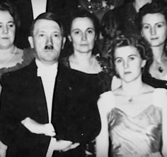 "Hitler and Eva Braun, 1938. What do we know about this evening? We know: 1. Eva's sister, Ilse, met Hitler for the first time ever. 2. Hitler bowled in the basement. 3. Hitler did the ""Blei Giessen,"" where a person pours liquid matter into a bowl to predict their next year's fortune 4. He and Eva went to bed at 2:45 am. Poor Hitler looks massively uptight here, note his habitual ""verklempt"" body language. (via putschgirl)"