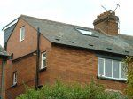 1910 Semi-detached house with hip to brick gable and rear flat roof dormer