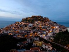 Sardinia: Emerald Coast. Soft dusk cloaks pastel-hued Castelsardo, a fortified hilltown on the northwest coast of Sardinia. Still little known by most Americans, Sardinia's northern coast is a corner of the Mediterranean adored by Italians and in-the-know Europeans.