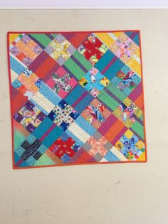 High Volume Scrappy X and Rail quilt