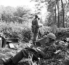 War correspondent Alan Wood, embedded with men of UK 1st Airborne Division, typing in woods near Arnhem, Gelderland, the Netherlands, 18 Sep 1944