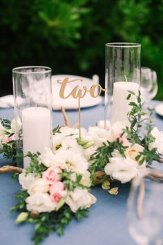 #table-numbers, #centerpiece  Photography: Brandon Kidd Photography - brandonkidd.net  Read More: http://www.stylemepretty.com/2014/08/12/intimate-playa-del-carmen-destination-wedding/
