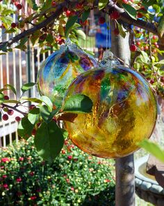 """A witch ball is a hollow sphere of plain or stained glass hung in cottage windows in 18th century England to ward off evil spirits or ill fortune.  The witch ball originated among cultures where witches were considered a blessing and these witches would usually """"enchant"""" the balls to enhance their potency against evils."""