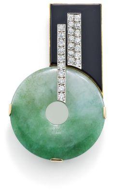An Art Deco jade, diamond and onyx pin, 1930  The jade disc offset below an onyx plaque and applied old brilliant-cut diamond linear motifs, Austrian assay marks to rear, length 6.2 cm, c. 1930.
