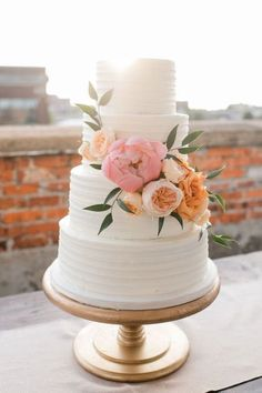 Simple, white, textured cake with beautiful flowers!