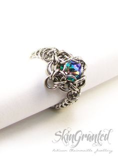 The Celtic Labyrinth chainmaille ring is a stunningly intricate and colourful addition to anyones collection. Inside a labyrinth of stainless steel