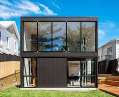 architecture project box house Daring Black Box Extension to a Heritage Worker's Cottage in New Zealand Box House Design, Cottage Design, Modern House Design, Container Home Designs, 40ft Container, Container Homes, Black Box, Black Trim, Residential Architecture