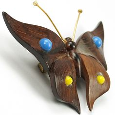 Deco Carved Wood and Inset Blue and Yellow Bakelite Highlights Butterfly Pin