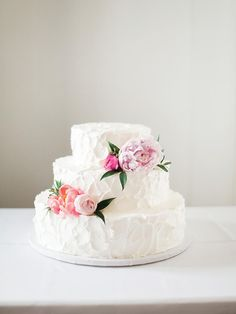 Short, wider tiers create a more uniquely shaped wedding cake that will be perfect for a bohemian-themed wedding