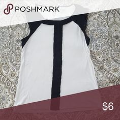 Elle White & Black Lacey Top Cute Elle white top with black lace and front strip emebellishment you can dress up or down. Made of cool and stretchy rayon and polyester material. Have worn this shirt many times and just noticed panels of shirt were not aligned properly when made. It was never apparent while wearing it. Price reflects. Otherwise in good condition from smoke-free home. Elle Tops Blouses