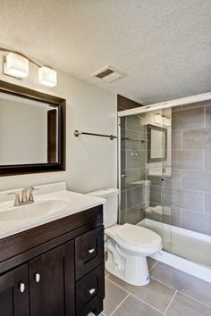 Contemporary Full Bathroom with Ms international metro charcoal 12 in. x 24 in. glazed porcelain floor and wall tile, Flush