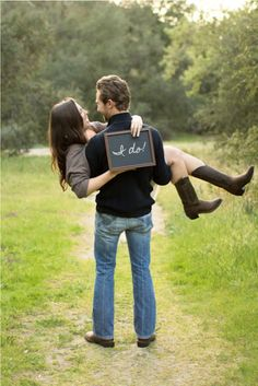 "cute Engagement photo ... if you add the wedding date to the chalkboard you also have a darling ""Save the Date"" photo"