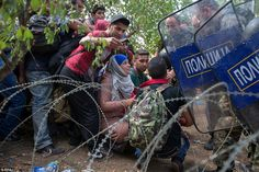 Human barrier: Today Macedonia decided to block the border with Greece, placing wire on the ground and sending riot police to prevent people crossing into their country - making the world's newest, and most hastily built, wall