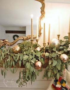 Creating a Christmas living room with colorful handpainted ornaments, brass candlesticks and lots of eucalyptus draped for a rustic boho mix. Christmas Staircase Decor, Christmas Mantels, Christmas Home, Christmas Crafts, Merry Christmas, Christmas Swags, Burlap Christmas, Victorian Christmas, Primitive Christmas