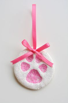 These puppy paw print salt dough ornaments are SO CUTE! And they're such a fun way to celebrate our furry friends! Such a sweet Christmas keepsake idea! Diy Christmas Decorations Easy, Diy Christmas Ornaments, Diy Christmas Gifts, Holiday Crafts, Xmas, Holiday Decor, Christmas Cookies, Homemade Ornaments, Purple Christmas
