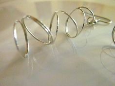 Twisted Metal Silver Spiral Earrings by kellyscraftitems on Etsy, $4.00