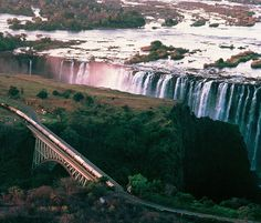 The Rovos Rial train travelling over the Victoria Falls Bridge.