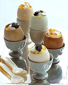 Prepare this special egg dish: scrambled eggs with creme fraiche and caviar in eggshell cups for a delicious breakfast.