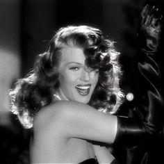 "Rita Hayworth as the legendary ""Gilda"" doing the spellbinding ""Put the blame on Mame"" number"