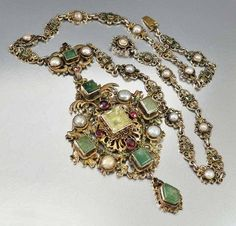 Exquisite and very elaborate antique Victorian Austro Hungarian necklace set with large natural emerald gemstones accented with pearls and rich garnets. The pen