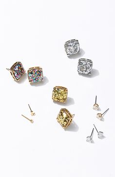 Sparkly glitter shines through the clear stones of these girly, party-perfect stud earrings by Kate Spade. These dazzling earrings come in a variety of colors and would make the perfect stocking stuffer!