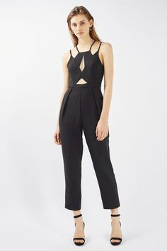 The jumpsuit transforms into a winning party-wear piece with this chic jumpsuit. In all black, it comes with cool double strap detail, mesh bust detail and a tapered peg leg. #Topshop