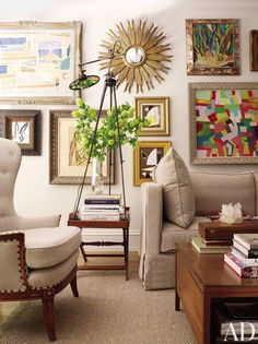 Gallery Wall How-To: 4. Mix it up with paintings, illustrations, sketches, and photographs. A sculptural piece or mirror could be a great, eclectic addition as well.