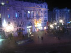Piccadilly Circus, London, lit up at night with promise and energy.