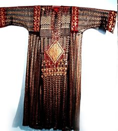 Egyptian dress made of vintage assiut with gold-toned stitches on black net, but mounted onto red.
