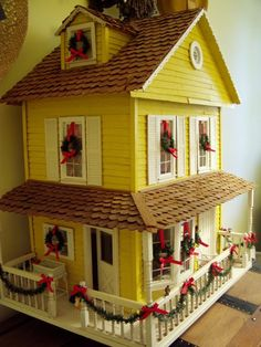 Dollhouse decorated for Christmas via Between Naps on the Porch