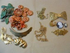 WTW 11/5/14 Using up some polymer flowers, beads, & leaves with some of my favorite B'sue brass leaves. Also have few cameos that I will attempt to design on the filigree pieces