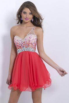 For the girl who loves color, the Blush 9859 prom dress really makes a splash. This bold, asymmetrical design features a sweetheart neckline topped with a single sheer strap with rhinestones and sequins scattered along the bodice. The natural waistline is accentuated by larger stones, which form a belt detail. Super short, skirt is gathered to an A-line while the hemline has a curled edge. The real piece de resistance however is the back.