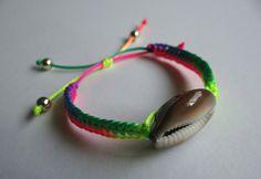 Cowrie shell bracelet. Handmade. Rainbow cord.