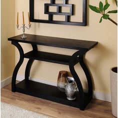 @Overstock - This contemporary console table features an intriguing black finish and an optional open storage shelf duo with amazing body structure design. This piece makes a great accent to any entry way, hallway, or even behind the sofa.http://www.overstock.com/Home-Garden/Sara-Black-Finish-Console-Table/6976064/product.html?CID=214117 $209.99