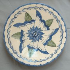 Thrown porcelain plate with Japanese inspired design.